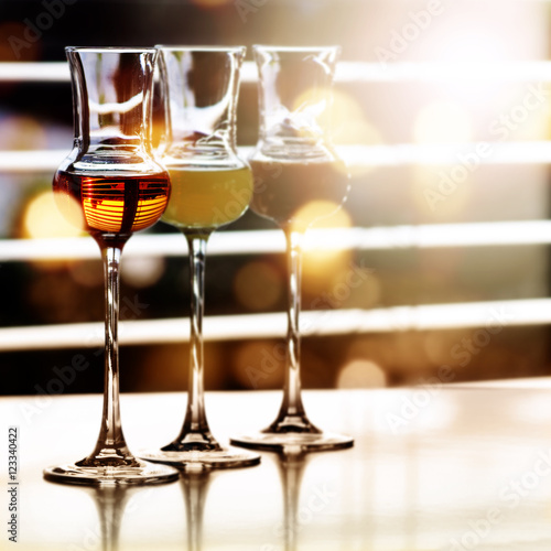 Alcoholic drinks in front of a window