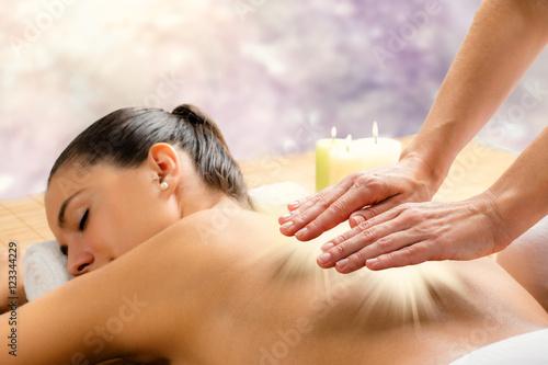 Photo  Conceptual reiki healing session.