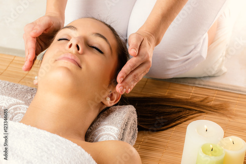 Photo  Face shot of woman at reiki session.
