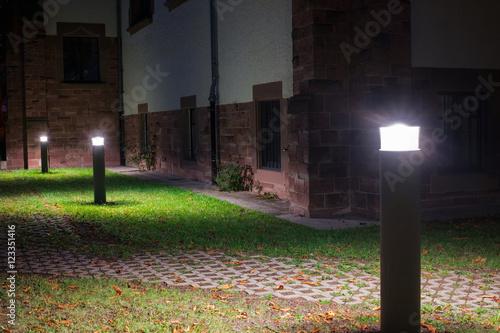 Fotografía  Outdoor lights (lanterns, bollards) in front of an old administration building i