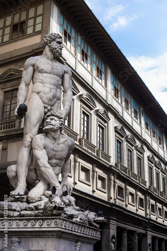 Fotomural Hercules and Cacus sculpture to the right of the entrance of the Palazzo Vecchio in the Piazza della Signoria (Signoria square), Florence, Italy