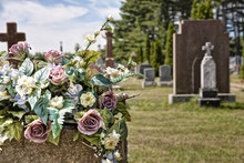 Flowers On A Headstones In A C...