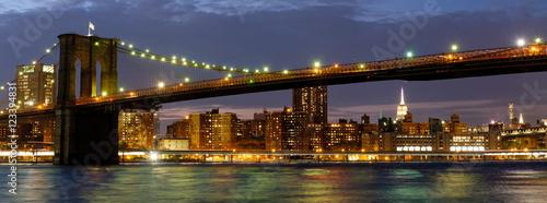 Poster Brooklyn Bridge Panoramic image of the Brooklyn Bridge illuminated at night