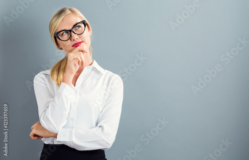 Obraz Young businesswoman in a thoughtful pose - fototapety do salonu
