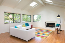 Bright And Spacious Simple White Living Room With Natural Sky-li