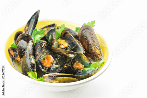 Fotobehang Schaaldieren Mussel soup and fresh parsley leaves with copy space