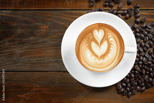 coffee cup  of coffee latte art and coffee beans on old wooden b Fototapet