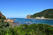 A tourist boat heading out through Knysna Heads, Western Cape, South Africa