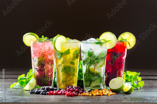 Fotografie, Obraz  Different types of mojito cocktail on dark brown background