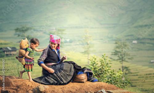 Fotografie, Obraz  Family tribal mother and daughter in rice terraces,Tu Le Lao Cai,Vietnam