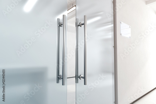 Blank glass door with metal handles mock up, 3d rendering. Office entrance with space sign board on wall mockup. Opened luxury hall doorway with transparent surface for your company logo design.