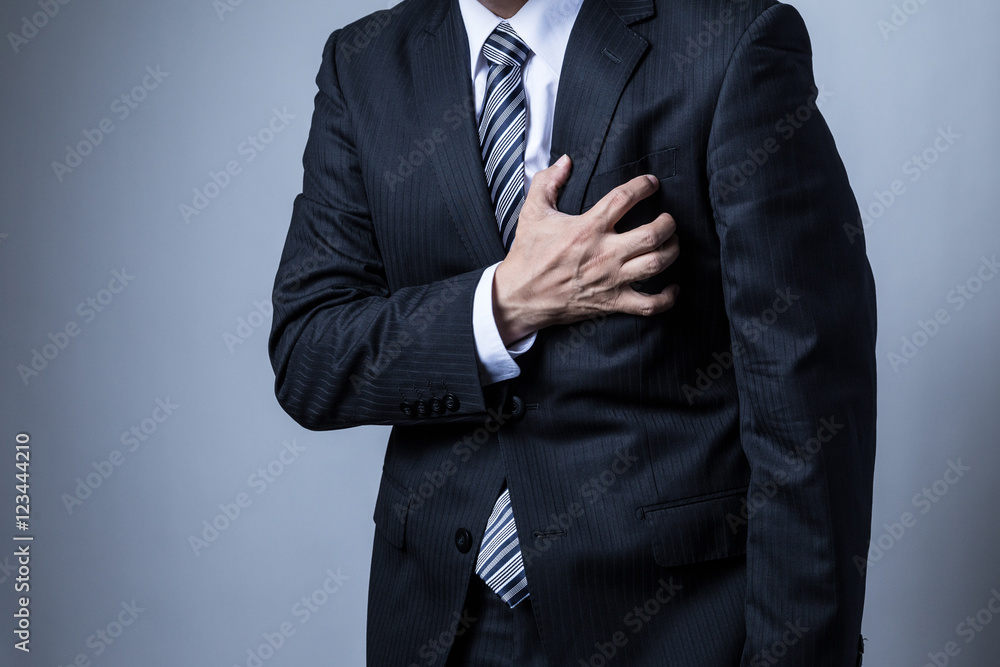 Fototapeta スーツを着ているビジネスマン、心疾患、心臓、心筋梗塞、狭心症