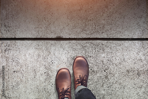 Fotografie, Tablou Steps, Go, Male with Leather Shoes Steps on Concrete Floor, Top view