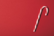 Christmas Festive Candy Cane On A Red Background