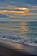 Waves Beneath a Summer Sunrise