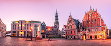 City Hall Square With House Of The Blackheads And Saint Peter Church In Riga Old Town During Sunset Time.