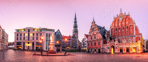 Fototapeta City Hall Square with House of the Blackheads and Saint Peter church in Riga Old Town During sunset time