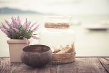 Wooden Surface At Beach Cafe With Vintage Style Accessories In Provence Style In Pastel Colors With Sea View And Copy Space As Holidays Background
