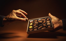 Box Chocolates In Hands