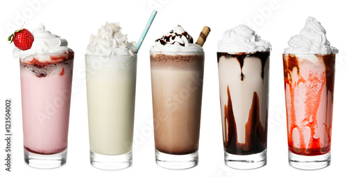 Glasses with delicious milk shakes on white background.