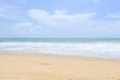 Empty sandy beach with sea under blue sky in thailand