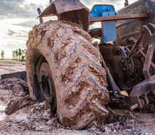 The Image Of The Tractor In The Mud