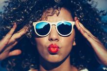 Portrait Of Beautiful Woman In Sunglasses