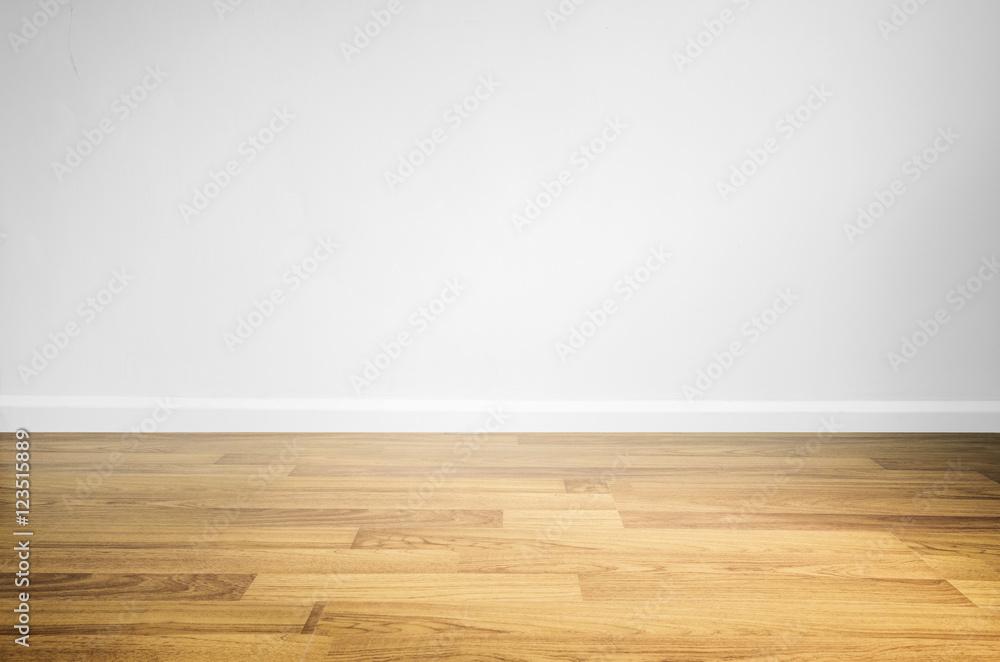 Fototapeta Laminated wood floor with white wall