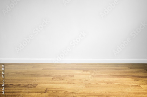 Laminated wood floor with white wall Canvas Print