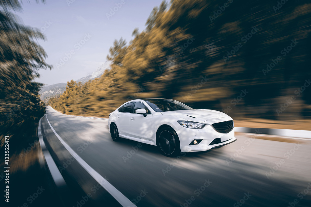 Fotografia, Obraz  White car speed driving on asphalt road at daytime