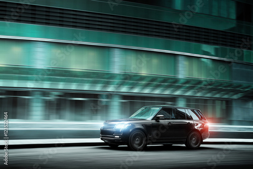 luxury-car-fast-drive-on-road-in-the-city