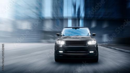 Fotografie, Obraz  Luxury car fast drive on road in the city