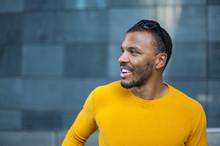 Smiling Man Wearing Yellow Pullover