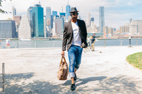 Handsome Young Freelance Portrait in Brooklyn , New York City . Manhattan Skyline on the Back Ground