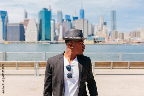 Young Fashionable Businessman Heading To Work . Manhattan Background New York City