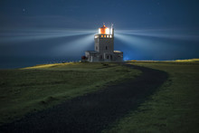 Illuminated Beacon Against Blue Sky