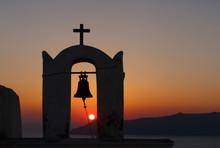 View On Sunset Through Bell Tower Of Agios Minas Church On Santorini