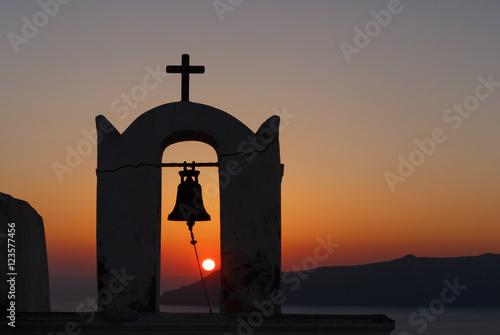 Obraz na plátně view on sunset through bell tower of Agios Minas church on Santorini