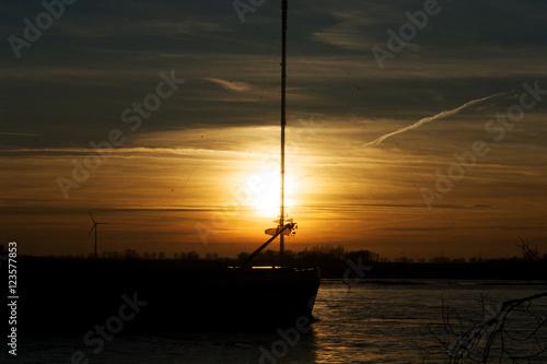 Foto auf AluDibond Pier Rhein bei Wesel Sonnenuntergang