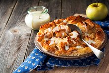 Bread Pudding Breakfast Casserole With Apples And Vanilla Sauce On The Old Wooden Background. Selective Focus.
