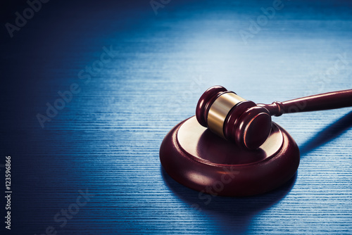 Valokuva  judge gavel on a blue wooden background