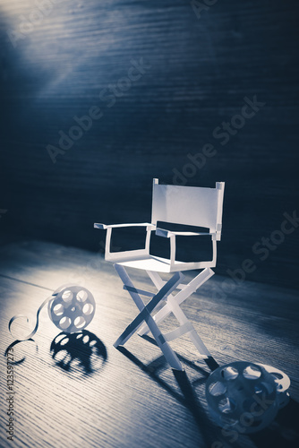 Fotografiet  paper director chair on a blueish grey background