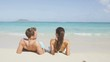 Beach relaxing on holiday vacations in holidays suntan concept - adults lying down tanning on luxury exclusive beach.