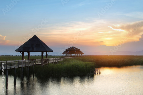 Foto op Plexiglas Crimson Beautiful panorama scenery of wood bridge during time the sunset and the beautiful colorful sky at Khao Sam Roi Yot National Park in Thailand is a very popular for photographers and tourists