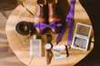 set of groom bow tie, watch, suspenders, belt and perfume lie on the background of vintage wooden table