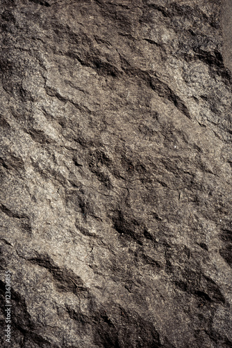 Tuinposter Stenen Stone background, rock wall backdrop with rough texture. Abstract, grungy and textured surface of stone material. Nature detail of rocks.