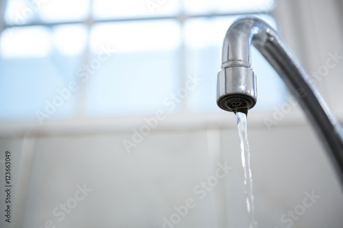 Close-up of water flowing from a tap