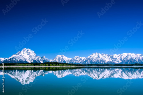 Fotografie, Obraz  Grand Tetons reflecting in Jackson Lake Wyoming