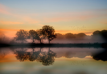 Obraz Stunning vibrant Autumn foggy sunrise English countryside landsc