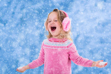 Little Girl Playing In Snowy P...